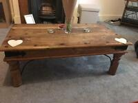 Solid wood coffee table with cast iron fixtures