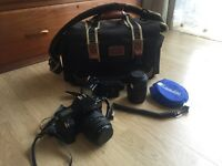 Canon 1000F SLR film camera with two lenses, flash gun and case