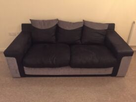 Black and grey leather and fabric sofa