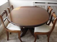 """Quality solid mahogany reproduction 48"""" diameter extending dining table and four chairs."""