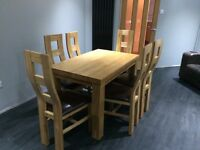 Dinning room solid oak table and 6 chairs