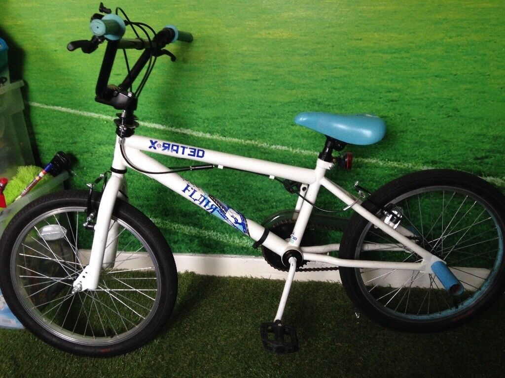 BMX blue and white x rated bmx with stunt pegs