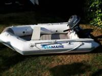 Inflatable dinghy with outboard