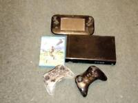 Nintendo Wii U with GamePad and two controllers. Comes with Legend of Zelda - Breath of the Wild