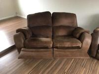 Brown material 3 & 2 seater reclining couches