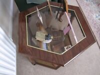 Hexagonal coffee table with glass top and lower shelf in excellent condition.