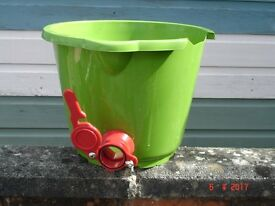 Green plastic bucket and tap suitable for jarring honey. Bee Keeping