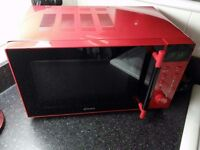 Small red microwave
