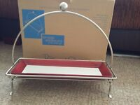 Pampered Chef brand new rectangle stand with simple addition platter