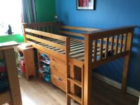 Two Mid sleeper Julian Bowen Cabin beds. With pull out desk, drawers and mini wardrobe. Versatile