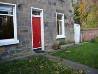 Lovely two bedroom main door flat with sizeable private garden, in the Stockbridge Colonies