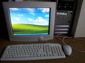 HP Compaq PC tower, monitor, keyboard and mouse