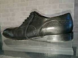 Size 11 black leather brogues