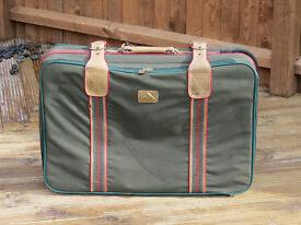 Green Constellation International suitcase. 76 x 50 x 20cm. Well travelled.