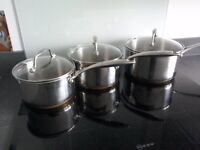 Set Copper bottomed saucepans