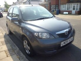 beautiful mazda 2 semi automatic,no clutch,five doors only 48000 miles,fsh,full years mot,all extras
