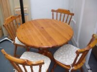 ROUND PINE TABLE AND 4 MATCHING CHAIRS