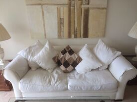 2 Sofas for sale - very good condition pale cream colour with Cushions - Collect Only staines area