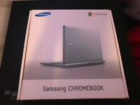 Samsung Chromebook XE303C12-A01 laptop in silver, with charger and boxed.