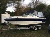 Cabin cruiser. Fishing boat. Rinker. Boat.