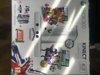 Xbox Kinect limited edition 4GB white. + 2 games. Never been used.
