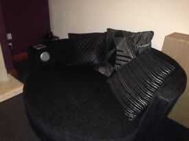 Black 2 seater sofa with built in docking station and 2 seater sofa