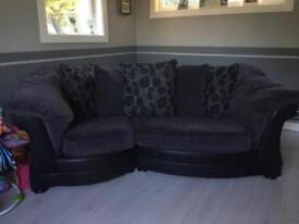 curved 3-4 seater back and grey couch
