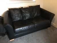 Black, leather, metal action sofabed