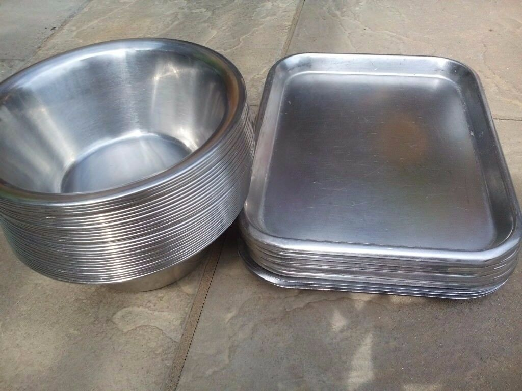 lots of stainless steal bowls and trays