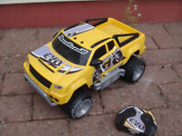 large remote control pick up truck plus 3 other cars