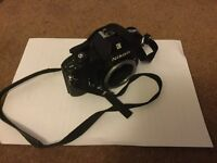 Nikon EM 35 mm body + lens