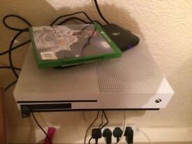 Xbox one s console and headset/charging docking station