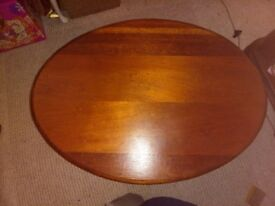 Wood coffee table with storage drawer