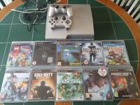 Silver ps3 320gb + 10 games + 2 dualshock controllers
