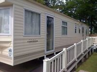 H A G G E R S T O N C A S T L E 8 BERTH CARAVAN TO LET .FAMILIES ONLY.