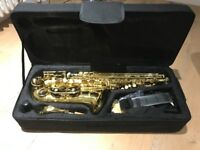 Alto E Flat Saxophone - brand new with case, books and accessories
