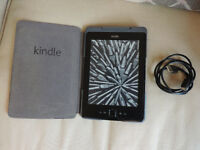 Amazon Kindle 4th Generation 2GB Wifi including a case with a built in Light.