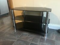 Glass unit . Black stereo or tv unit. Corner or flat wall