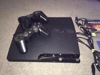 Slim PlayStation 3 plus 5 Games