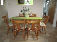 Pine table and 6 chairs length 54 inc closed 68 extended.