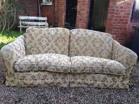Comfortable two/three seater fabric sofa.