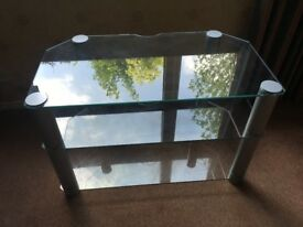 Clear Glass Television Table with top and 2 shelves. Good condition .