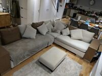 Large modular L-shaped sofa with shelf ends and foot-stool