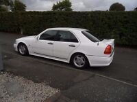 Mercedes C180. Genuine AMG bodykit and wheels, may swap for motorbike