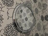 Round wall mirror with metallic frame