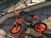 """Smyths 14"""" striker orange boys bike"""