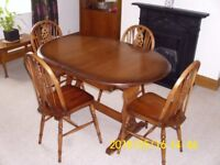 Classic solid oak extending dining table and 4 chairs