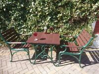 A CAST IRON TABLE AND 2 CHAIRS FOR A GARDEN, PATIO OR CONSERVATORY