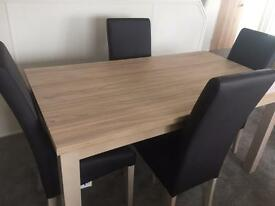 Brand new oak dining table with 4 x faux leather chairs