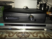 Xbox 360 with 2 wireless controller and some games available for sale
